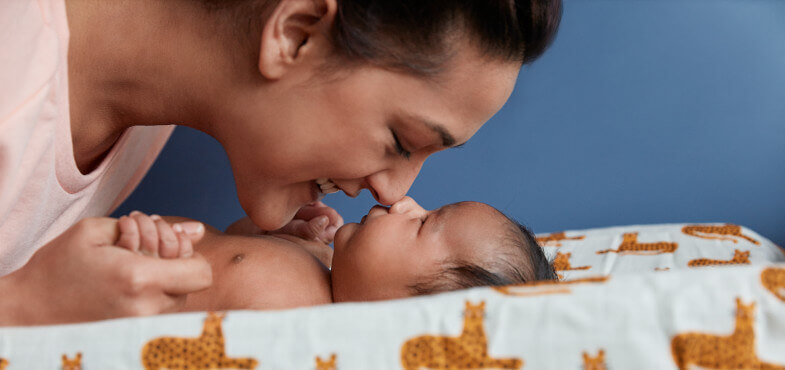 Mom and newborn touching nose to nose